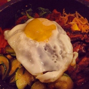 Dolsot bibimbap, a rice bowl with veggies, beef & sunny-side up egg.