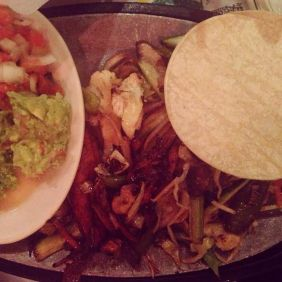 Veggie fajitas with beans, rice and corn tortillas.